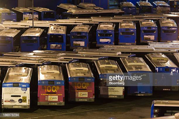 Buses stand idle at the Empresa Municipal de Transportes de Madrid bus depot on the morning of a general strike in Madrid Spain on Wednesday Nov 14...