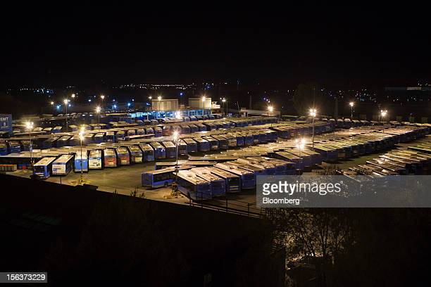 Buses stand illuminated at the Empresa Municipal de Transportes de Madrid bus depot on the morning of a general strike in Madrid Spain on Wednesday...