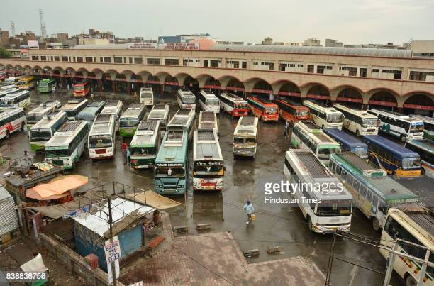 Buses stand parked at a bus stand in Amritsar on Friday after a majority of buses were cancelled due to Dera Sacha Sauda chief Gurmeet Ram Rahim's...