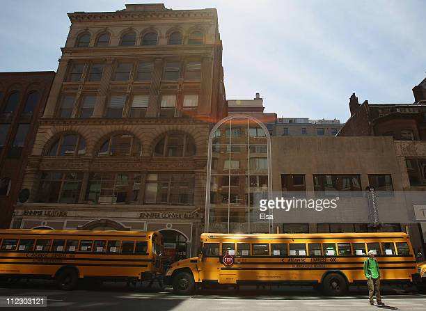 Buses wait at the end of the 115th Boston Marathon to transport runners on April 18 2011 in Boston Massachusetts