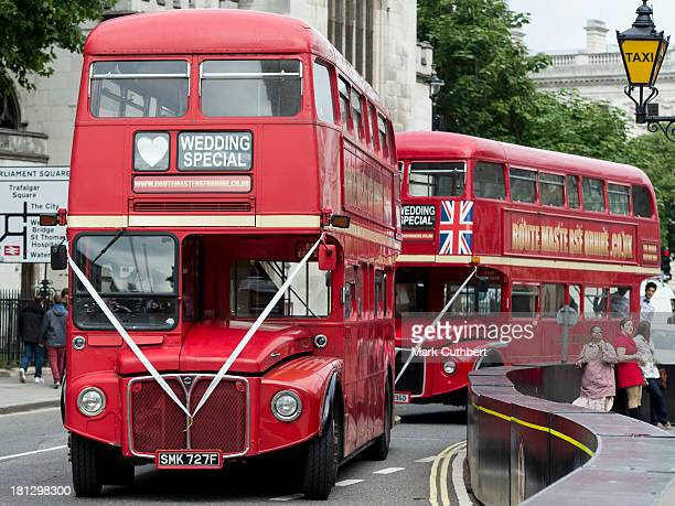 Buses wait to take the guests to the reception at the wedding of Alexander Fellowes and Alexandra Finlay at St Mary's Undercroft on September 20 2013...