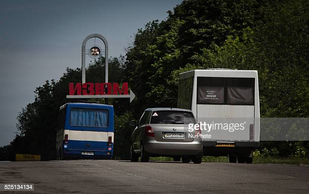 Buses with refugees from ATO zone enter the Izium town in Kharkiv region