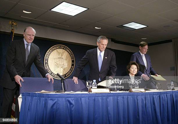 Bush administration officials US Treasury Secretary John Snow leftright Commerce Secretary Donald Evans Labor Secretary Elaine Chao and US Trade...