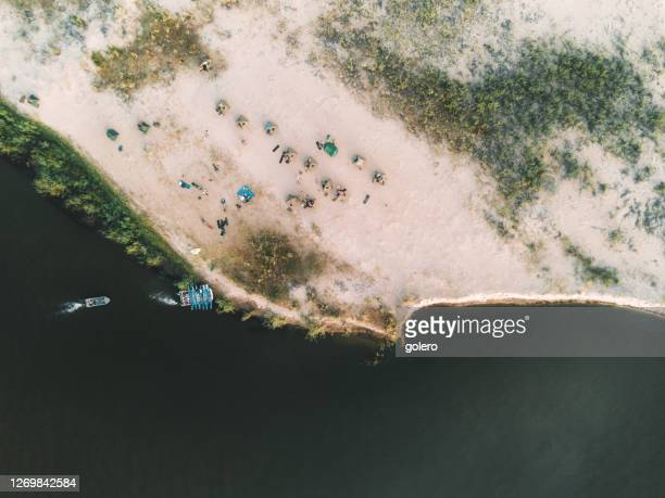bush camping on zambezi river island - zambezi river stock pictures, royalty-free photos & images