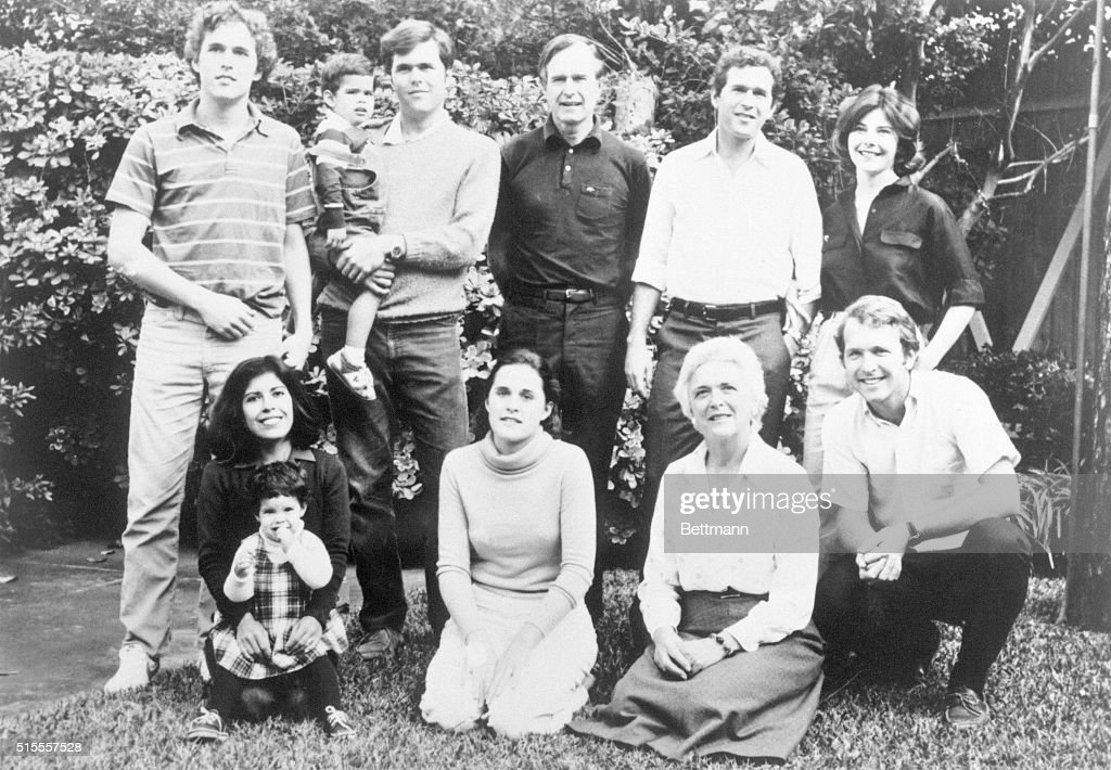 Marvin, 22; George, 3; Jeb, 26; George; George W., 33; George's wife, Laura. Bottom, left to right: Jeb's wife, Columba; Noelle, 2; Dorothy, 20; Barbara; Neil, 24.