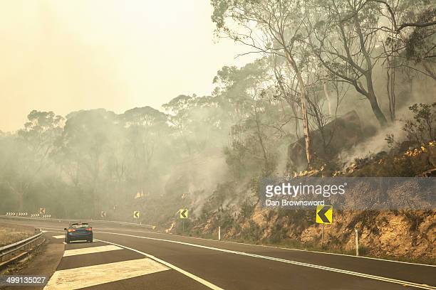 bush fire and highway, new south wales, australia - forest fire stock pictures, royalty-free photos & images