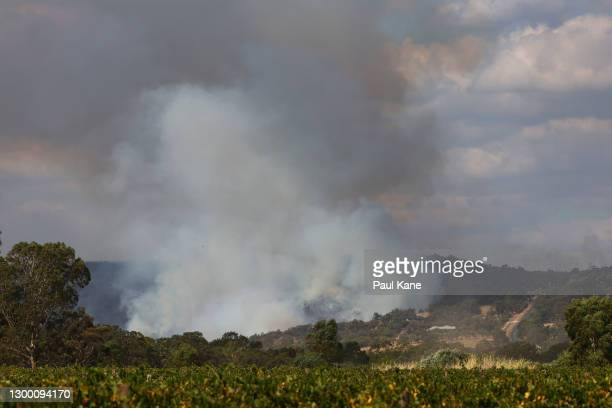 Bush fire is seen threatening Avon Ridge in Brigadoon on February 03, 2021 in Perth, Australia. The Rapid Damage assessment team have identified 71...