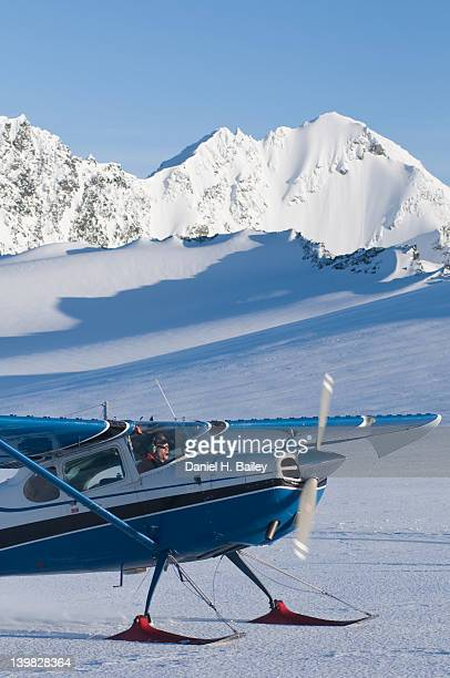 bush pilot inside his cessna 170 airplane on the eagle glacier, chugach mountains, alaska - chugach mountains stock pictures, royalty-free photos & images