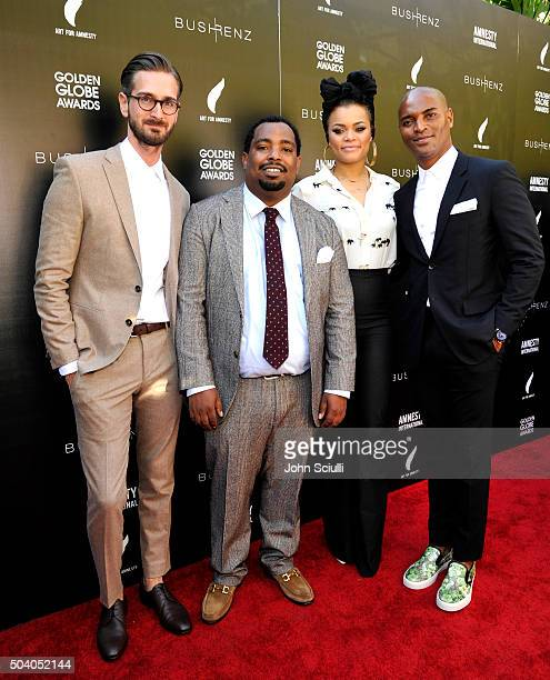 Bush Renz cofounder Christopher Renz Art for Amnesty creative director Marvin Bing singer Andra Day and Bush Renz cofounder Gerard Bush attend the...