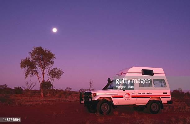 4WD bushcamper and full moon at dusk.