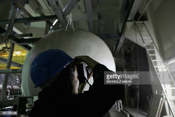 An Iranian female photographer of a US photo agency takes pictures inside the tourbine building of the Bushehr nuclear power plant in the Bushehr...
