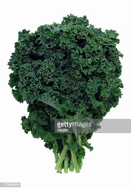 bushel of green kale on white background - kale stock pictures, royalty-free photos & images