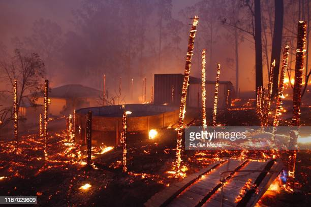 A bushfire breaks containment lines crosses the Pacific Highway and burns through properties in the township of Rainbow Flat on the Mid North Coast...