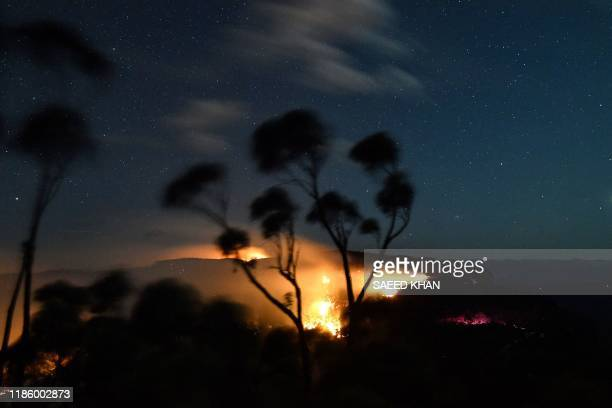 A bushfire burns out of control in the Blue Mountains of the New South Wales on December 2 2019 Bushfireprone Australia has experienced a horrific...