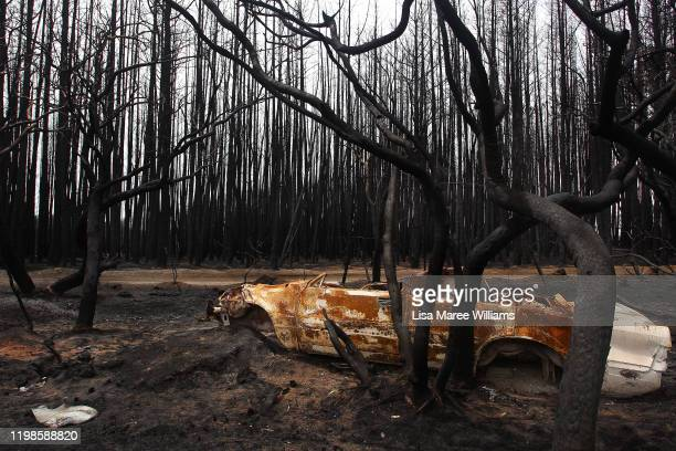 A bushfire damaged car is seen on the edge of the Playford HIghway west of Parndana on January 10 2020 on Kangaroo Island Australia Over 100000 sheep...