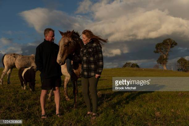 Bushfire survivors Mick Thompson and Marylin Mills is pictured on her Cobargo property on May 09 2020 in Cobargo Australia Marylin Mills and her...