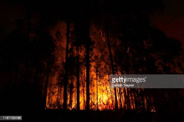 Bushfires are seen between the towns of Orbost and Lakes Entrance in east Gippsland on January 02 2020 in Australia The HMAS Choules docked outside...