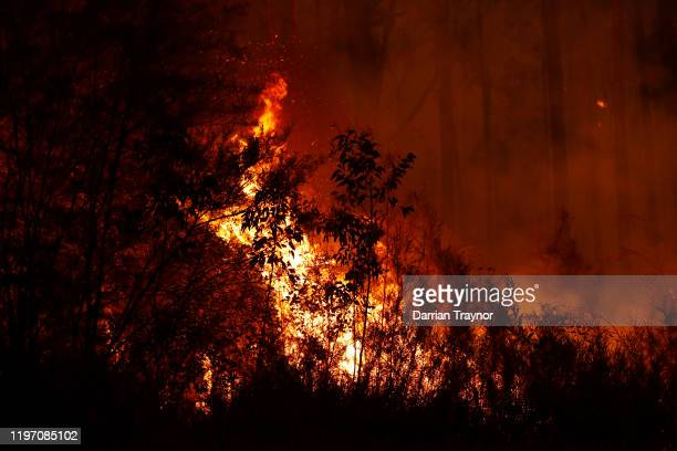 Bushfires burn between the townships of Bemm River and Cann River in eastern Gippsland on January 02 Australia The HMAS Choules docked outside of...