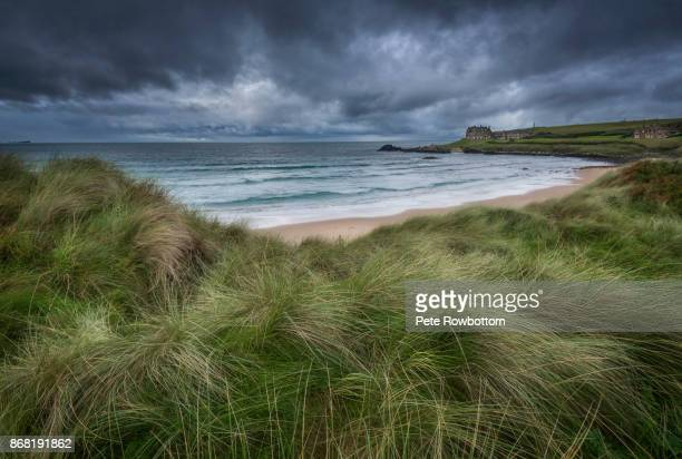 bushfoot strand seastorm - county antrim stock pictures, royalty-free photos & images