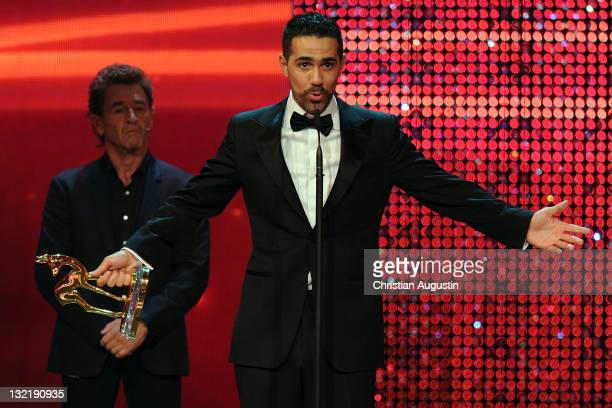 Bushido receives the Integration award from Peter Maffay during the Bambi Award 2011 show at the RheinMainHallen on November 10 2011 in Wiesbaden...