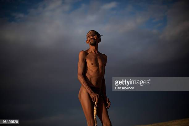 A bushman from the Khomani San community strikes a traditional pose in the Southern Kalahari desert on October 15 2009 in the Kalahari South Africa...