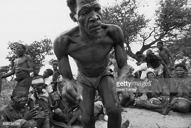 A bushman of the Ganakwe tribal group leads a lion dance at sunset He is said to become a lion in his trance state