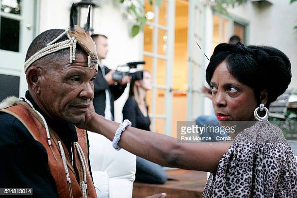 Bushman Roy Sesana is treated by Jessie Haugabook a Sangoma at the private reception for the Gana and Gwi San Bushmen of Botswana held at the home of...