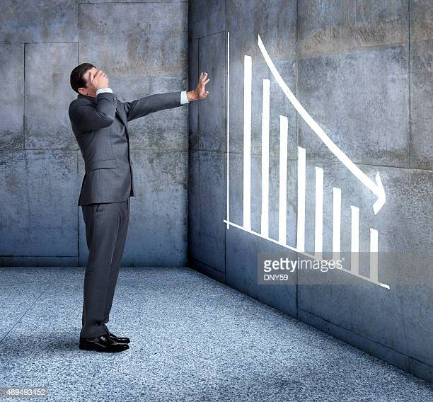 busienssman can't bear to watch falling sales - distressed stock market people stock pictures, royalty-free photos & images