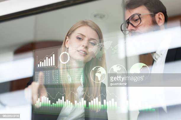 Busines couple discussing business profit on a modern interface