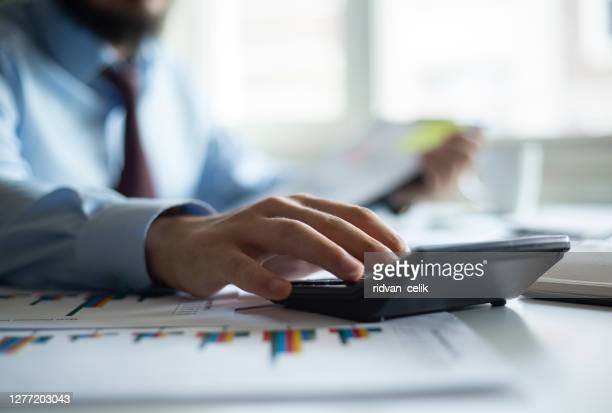 business accounting concept, business man using calculator with computer laptop, budget and loan paper in office. - accountancy stock pictures, royalty-free photos & images