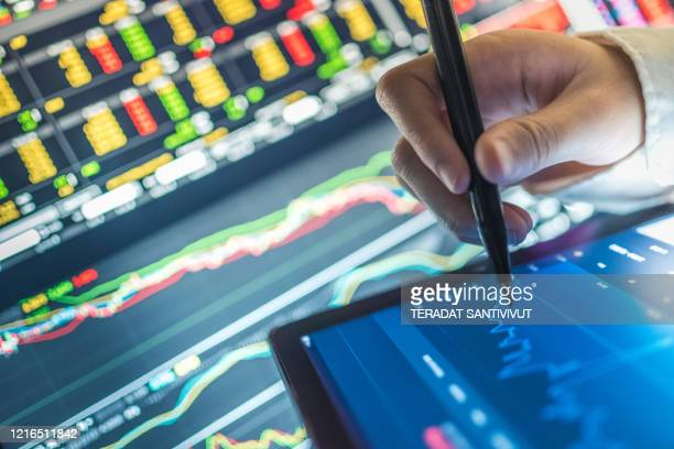business analysis stockmarket chart in tablet and computer for investment in crisis and finance business planning selective stock , cryptocurrency , and fund for stockmarket crash and financial crisis - ai stock pictures, royalty-free photos & images