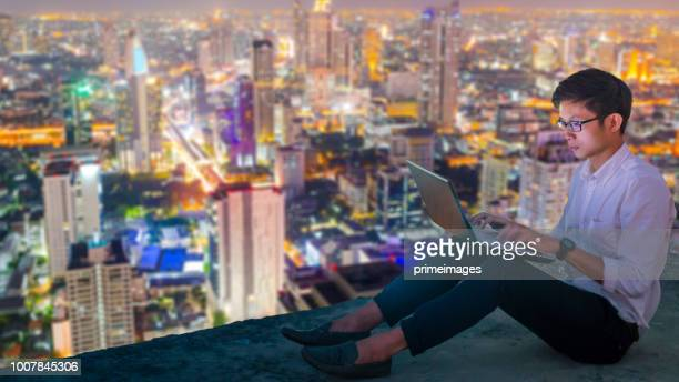 business analysis stockmarket with digital tablet  with skyscaper background - education building stock pictures, royalty-free photos & images