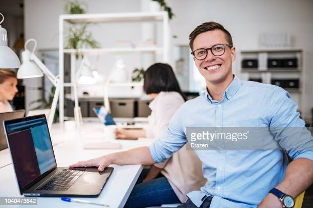 business and coworking with multi-ethnic professionals in sweden. - northern european descent stock pictures, royalty-free photos & images