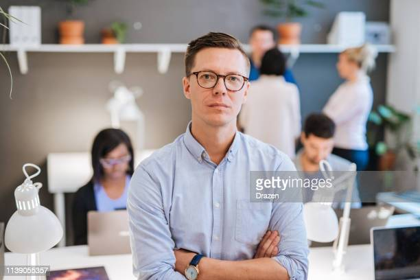 business and coworking with multi-ethnic professionals in sweden. - scandinavian descent stock pictures, royalty-free photos & images