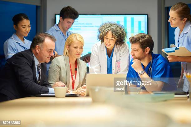 business and medicine meet - group of doctors stock pictures, royalty-free photos & images