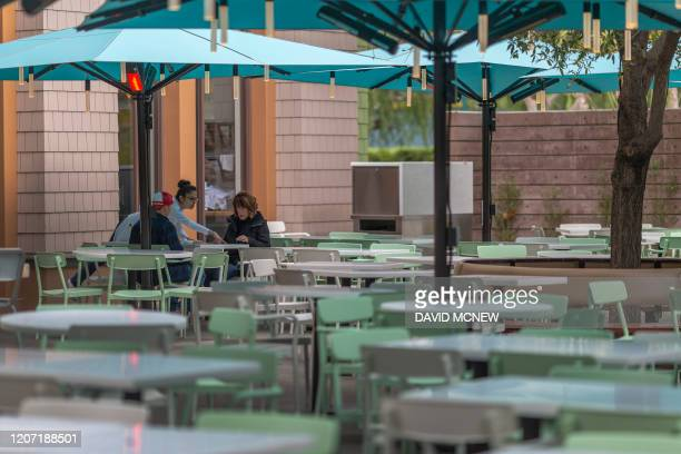 Business appears slow at the Naples Ristorante e Bar restaurant in Downtown Disney District shopping mall which remains open on the first day of the...