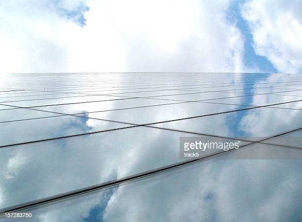 Business architecture forming a futuristic glass horizon with blue sky
