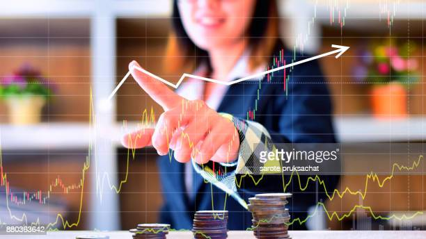 Business Asian  woman pointing at something on screen . investment financial concept .