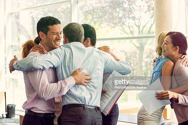 Business associates celebrating team success