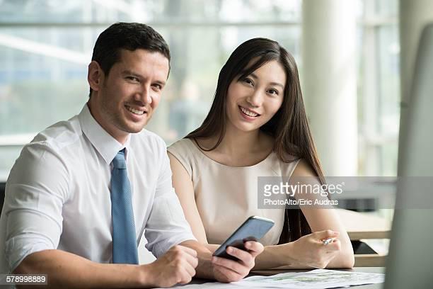 Business associates collaborating, portrait
