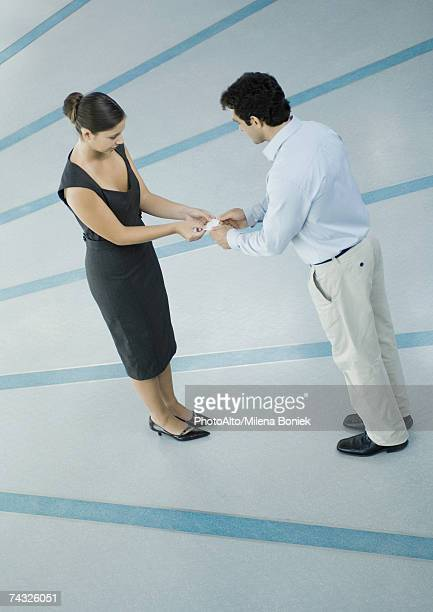 Business associates exchanging business cards