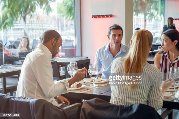 Business associates having lunch together in restaurant