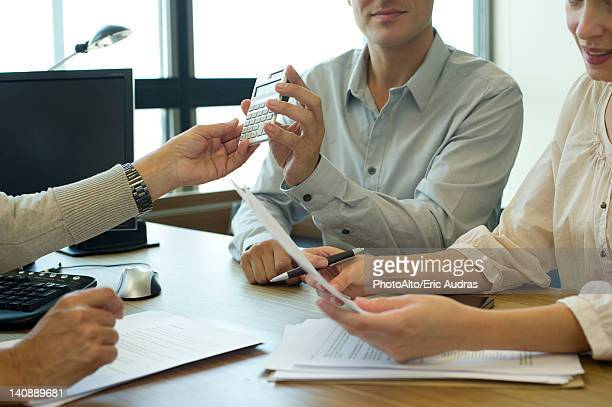 Business associates negotiating deal, cropped