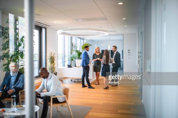 business associates relaxing on break from corporate seminar - employee engagement stock pictures, royalty-free photos & images