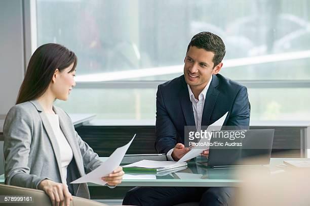 Business associates reviewing document