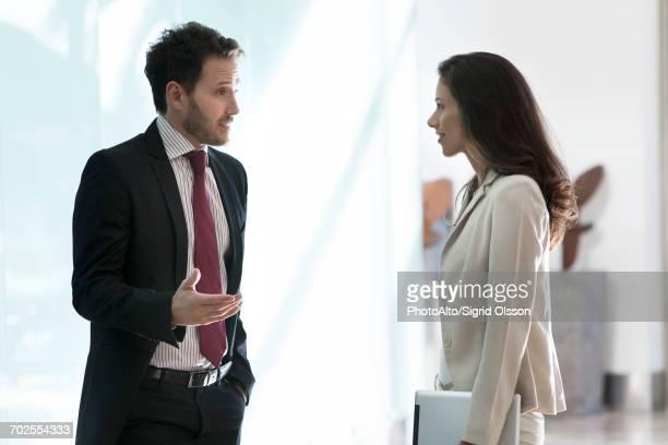 Business associates talking in office