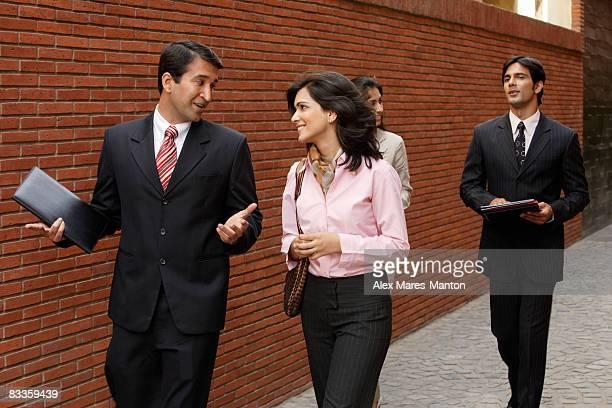 business associates, walking