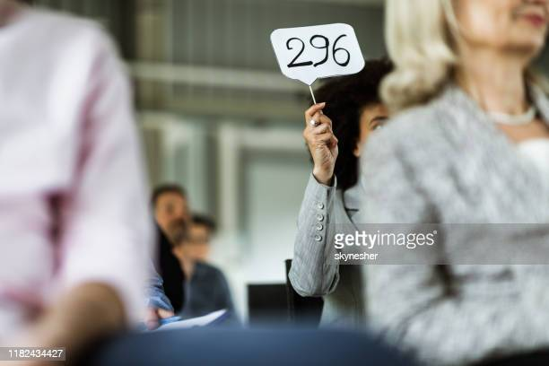 business auction in board room! - auction stock pictures, royalty-free photos & images