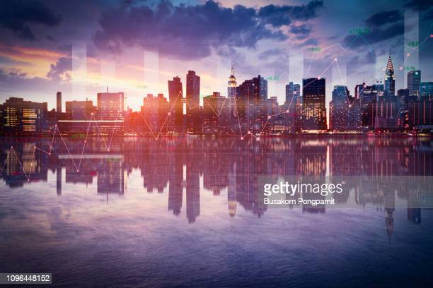 business background with stock graph growth on the city skyline view. - börse new york stock-fotos und bilder