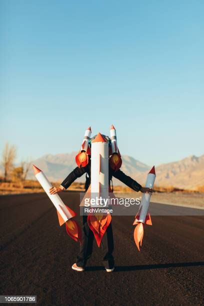 business boy holding rockets - launch event stock pictures, royalty-free photos & images